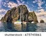 catamaran yacht anchored off a... | Shutterstock . vector #675745861