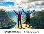 couple standing against amazing ... | Shutterstock . vector #675779671