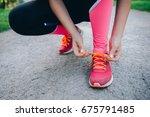 lacing the sneakers  | Shutterstock . vector #675791485