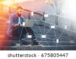young businessman sits outdoor... | Shutterstock . vector #675805447