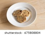 nuts cookies in small white... | Shutterstock . vector #675808804