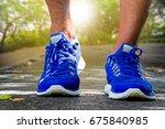 man wearing sport shoes running ... | Shutterstock . vector #675840985