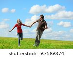 young happy lovers running on... | Shutterstock . vector #67586374