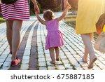 granddaughter holding hands of... | Shutterstock . vector #675887185