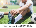 selective focus of soccer... | Shutterstock . vector #675891094