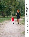 mom and little daughter walking ... | Shutterstock . vector #675910015