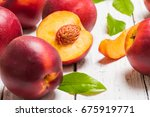 Nectarines On A Light Wooden...