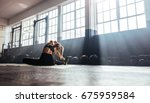 young woman working out in gym. ... | Shutterstock . vector #675959584