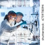 health care researchers working ... | Shutterstock . vector #675978094