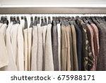 men's sweaters on hangers in... | Shutterstock . vector #675988171