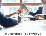real estate agent giving them... | Shutterstock . vector #675995929