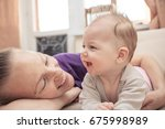 happy mother looking and... | Shutterstock . vector #675998989