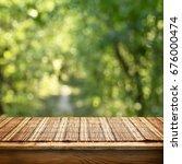 empty bamboo table | Shutterstock . vector #676000474