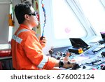 the captain controlled the boat ... | Shutterstock . vector #676002124