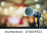 microphone on abstract blurred... | Shutterstock . vector #676019521