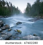 fast river in northern Russia is covered in mist - stock photo