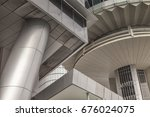 Small photo of 11 November 2014: Singapore - Singapore architecture abstract. The buildings are the OUE Tower and OUE Bayside building, on Colliers Quay.