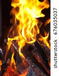 flames from a fire on a black...   Shutterstock . vector #676035037