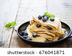 homemade  crepes served with... | Shutterstock . vector #676041871