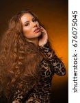 girl in leopard dress and black ... | Shutterstock . vector #676075045