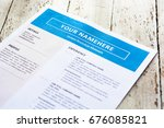 Small photo of Template resume on white paper with blue theme. Focus on name title and blurred other titles.