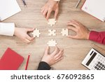 team completes the puzzle on... | Shutterstock . vector #676092865
