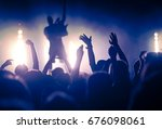 crowd at concert   summer music ... | Shutterstock . vector #676098061