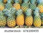 green and yellow pineapple on... | Shutterstock . vector #676100455