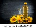 sunflower oil with flowers on... | Shutterstock . vector #676106131