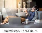 young asian man using... | Shutterstock . vector #676140871