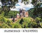 medieval eltz castle nestled in ... | Shutterstock . vector #676149001
