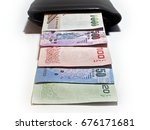 pack of thai money baht in... | Shutterstock . vector #676171681