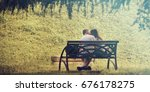 couple kiss on a bench ...   Shutterstock . vector #676178275
