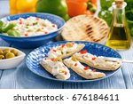 feta cheese spread with olives... | Shutterstock . vector #676184611