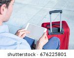person using a digital tablet... | Shutterstock . vector #676225801