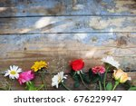 Bouquet Of Flowers On A Wooden...