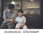grandfather and grandson... | Shutterstock . vector #676243669
