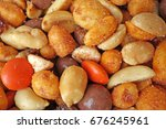 mixed peanuts and chocolate... | Shutterstock . vector #676245961