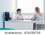 friendly female doctor... | Shutterstock . vector #676258729