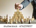 businessman placing a chess... | Shutterstock . vector #676259857