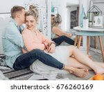beautiful young couple in love | Shutterstock . vector #676260169