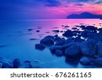 rocky sea shore before sunrise. ... | Shutterstock . vector #676261165
