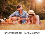picnic time. young couple... | Shutterstock . vector #676263904