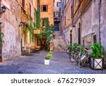 view of old cozy street in rome ... | Shutterstock . vector #676279039