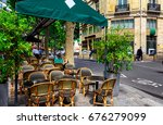cozy street with tables of cafe ... | Shutterstock . vector #676279099