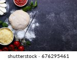 raw dough for pizza with... | Shutterstock . vector #676295461