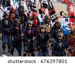 Small photo of Gifu, Japan - October 4, 2015: Historical reenactment arquebus firearms squad during the 59th annual Nobunaga Festival parade