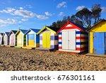 brighton beach bathing boxes in ... | Shutterstock . vector #676301161
