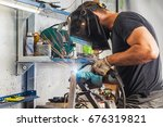 a young brunette man welder in... | Shutterstock . vector #676319821
