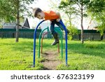 boy playing outdoors. kid on... | Shutterstock . vector #676323199